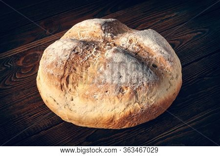 Homebaked Bread. Wheat Bread On A Wooden Background. Homemade Baking. Toned Image.