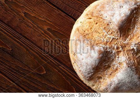 Homebaked Bread. Top View Wheat Hot Bread On A Wooden Background With Space For Text. Homemade Bakin