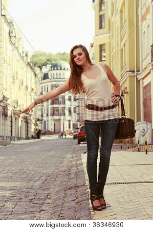 Young Woman Hailing A Cab
