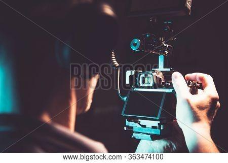 Caucasian Men In His 30s Taking Documentary Film Shots Handheld Using Professional Dslr Camera. Vide