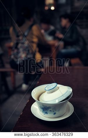 CHONGQING, CHINA – MARCH 13: Tea cup on table on March 13, 2018 in Chongqing. The lifestyle of the old 80's is preserved in this Tea House as the famous tourism attracitions.