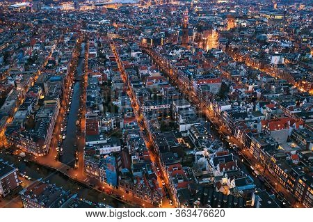 Aerial Evening Amsterdam View With Narrow Canals, Streets And Historic Buildings, View From Above, N