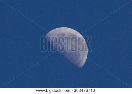 Close Up Of The Half-moon At Blue Sky