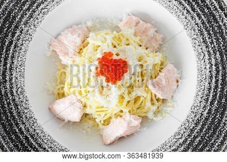 Italian Pasta With Red Fish, Parmesan And Red Caviar. Serve In A Plate, Top View.