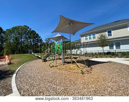 Orlando, Fl/usa-4/1/20: A Park With A Playground And Nature With Caution Tape And No Trespassing Sig