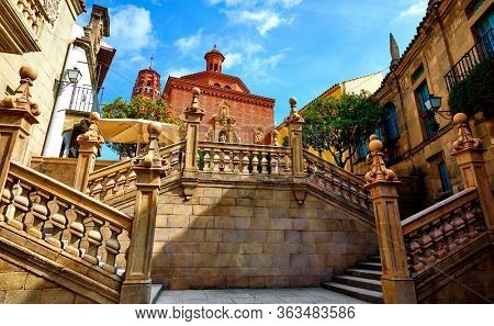Vintage stairs in Spanish village (Poble Espanyol) museum open air in Barcelona. Spain. Traditional building in old town. Scenic landscape landmark.