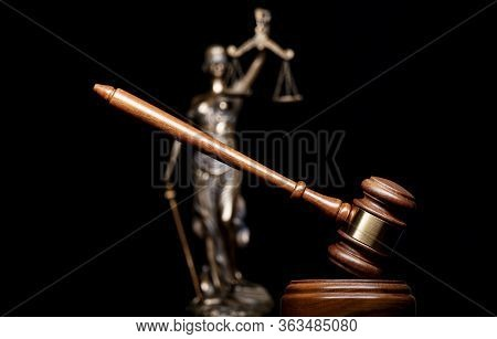 A Gavel And Bronze Themis Statue - Symbol Of Justice - Isolated On Black