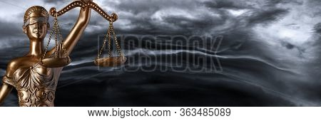 Bronze Themis Statue - Symbol Of Justice With A Smoky Background