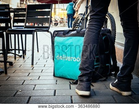 Paris, France - Feb 23, 2019: Big Square Deliveroo Square Thermobag In Front Of Restaurant Entrance