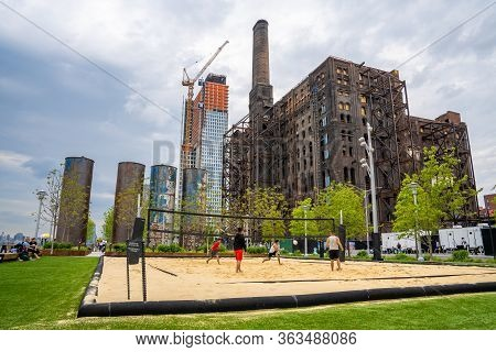 New York, Usa. May 20, 2019. People Playing Beach Volley In Domino Park Sign In Williamsburg, New Yo