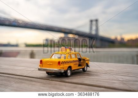 New York, Usa. May 12, 2019. Classic Taxi Model Parked At Domino Park Sign In Williamsburg, New York