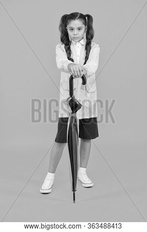 Cute Schoolgirl Feel Protected For Spring Weather. Waterproof Concept. Match Your Raincoat With Umbr