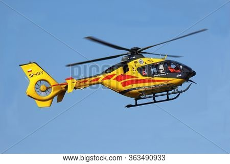 Wroclaw, Poland - August 7th 2014:   Yellow rescue helicopter at blue sky