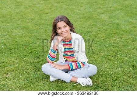 Beautiful Girl Relaxing On Grass. Having Rest In Summer Park. Concept Of Rest And Relaxation. Spring