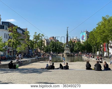 Brussels, Belgium - April 25, 2020: Jules Anspach fountain and Quai aux Briques in a bright Spring day during the confinement covid-19 - deconfinement, freedom