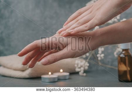 Beautiful Female Hands Care For The Skin, Apply Cream And Oils. Light Fluffy Beige Towels With Spa P