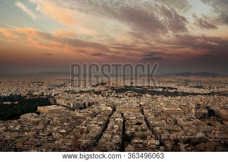 Athens skyline sunrise viewed from Mt Lykavitos with Acropolis, Greece.