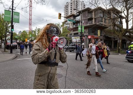 Downtown Vancouver, Bc, Canada - Apr 26, 2020: An Antifa Member Disrupts An Anti Lockdown Protest Ma