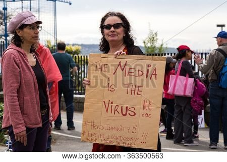 Downtown Vancouver, Bc, Canada - Apr 26, 2020: Anti Lockdown Protesters March In Defiance Of The Gov