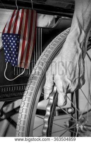 Senior In Wheelchair At Nursing Home In Black And White With Hanging Us Flag Face Mask In Color. Con