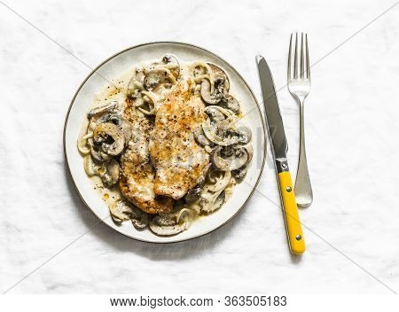 Fried Chicken Fillet With Cheesy Mushrooms Cream Sauce On A Light Background, Top View. Delicious Ho