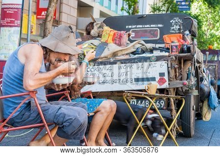 Brisbane Australia - March 16 2013; Non-urban People Eating Breakfast On Road At Back Of Rustic Old