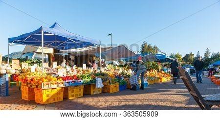 Rotorua New Zealand - July 11 2013; People Buying And Selling Fresh Produce At Rotorua Farmers Marke