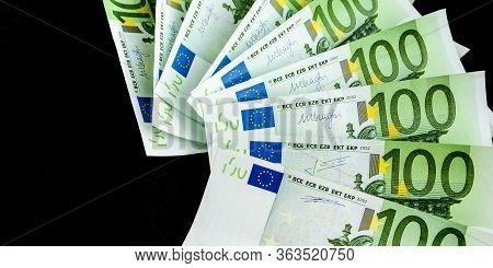 100 Euro - Full Set Of Banknotes Of Euro Isolated On Black, One Hundred Euro Banknotes On A Dark Bac