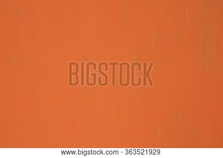 Metallic Wall Background, Texture, Colored In Orange Color. Old Metall Surface With Faded Uneven Col