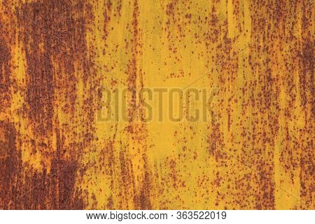 Metallic Wall Background, Texture, Colored In Fiery Yellow Color. Old Rusty Metal Surface With Faded