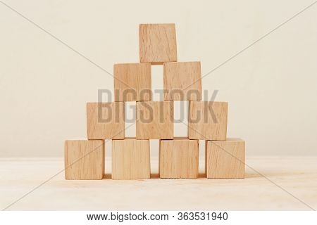 Wooden Cube Stacked Into A Pyramid. Wooden Cube Stacked