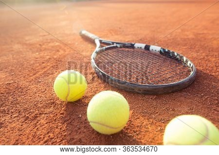Close Up View Of Tennis Racket And Balls On The Clay Tennis Court, Recreational Sport, Leisure Time