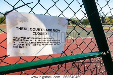 Tennis Courts Closed Sign Due to Coronavirus COVID-19 Pandemic