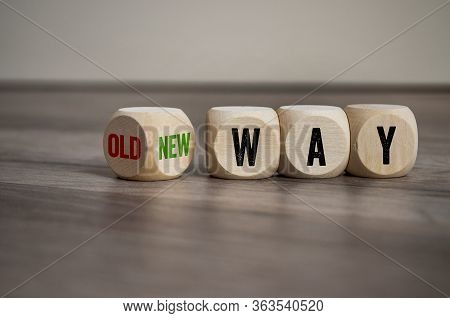 Cubes And Dice With Message Old Way And New Way On Wooden Background