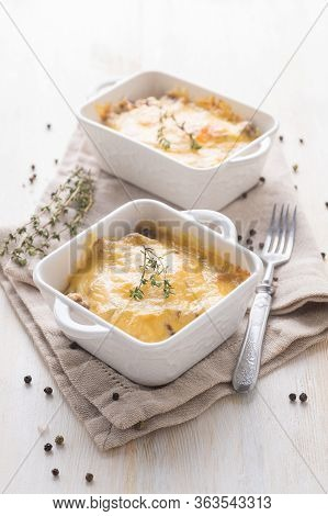 Traditional Cheese Casserole With Chicken And Mushrooms And Herbs In A Serving Plate. Ready To Eat.