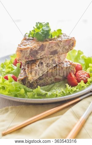Homemade Frittata With Meat And Vegetables. Large Pieces Of Omelette On A Plate With Fresh Lettuce A