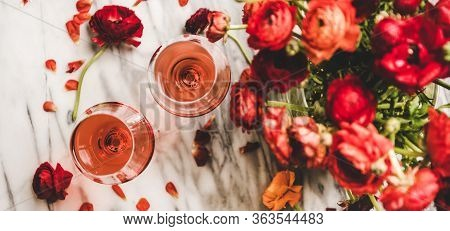 Rose Wine In Glasses And Red Spring Flowers, Wide Composition