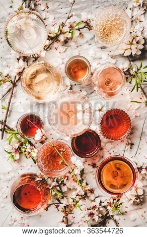 Various Shades Of Rose Wine Over White Marble Background