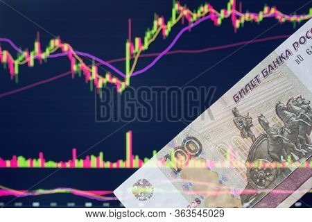 Russian Rubles Against The Background Of The Exchange's Trading Schedule. Trading Stocks, Bonds, And