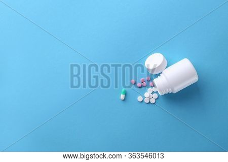 Pills On A Blue Background. Top View. Empty Space For Text