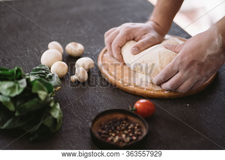 Chef Baker Hands Kneading Pizza Dough At Kitchen, Close Up. Food Delivery, Restaurant Meals Preparin