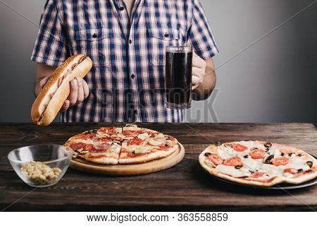 Nerve Food, Addiction, Eating Disorders, Bulimia. Overweight Man Eating Junk Food And Drink Beer. Fo