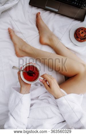Photo Of Breakfast In Bed. Morning, Coffee In Bed, Breakfast, Girl. Photo Of Female Legs In A White