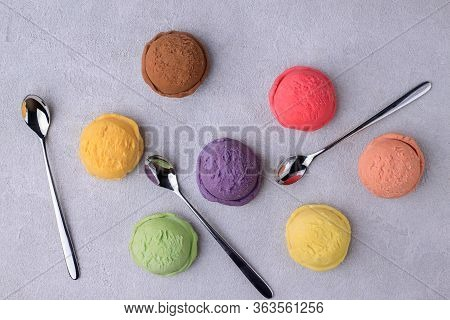 Various Flavored Ice Cream Scoops On Stone Table Flat Lay. Food Background, Refreshment, Rainbow, Va