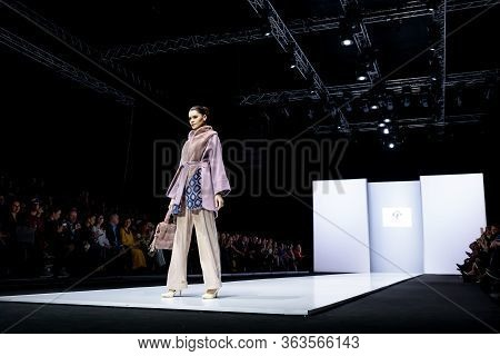 Moscow, Russia - March 21, 2019: Model Walk Runway For Duetfur Crimean Fur Factory Catwalk At Autumn