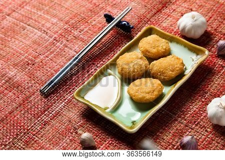 Fried Shellfish Balls. Chinese Traditional Cuisine Concept. Dumplings Dim Sum In Bamboo Steamer With