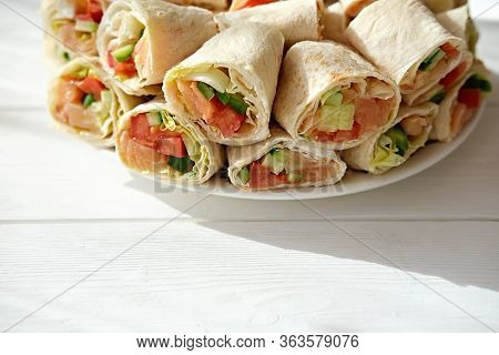Pita Salmon Rolls With Cucumbers, Tomatoes And Letuce. Asian Style Rolls Made With Tortilla. Delicio