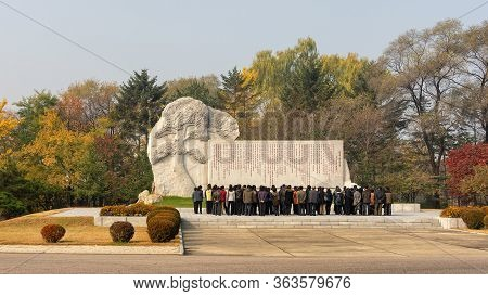 Pyongyang / Dpr Korea - November 12, 2015: People Pay Respects In Front Of A Communist Monument In P