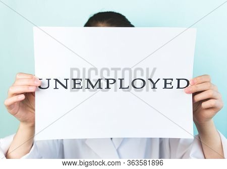 A White Paper Sheet With The Words Unemployed In Hands. The Jobless Status Is Over, Find New Jobs. T