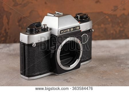 The Old Soviet 35 Mm Film Camera Kiev 19 Without Lens With Nikon Mount, Released 1989 On Brown Cemen